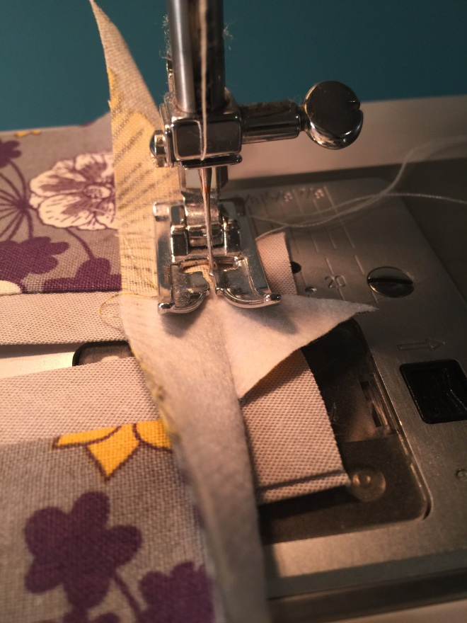 Sew close but don't catch the accent fabric